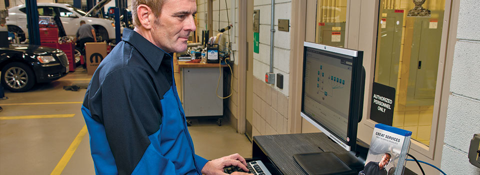 Man looking up parts on a computer